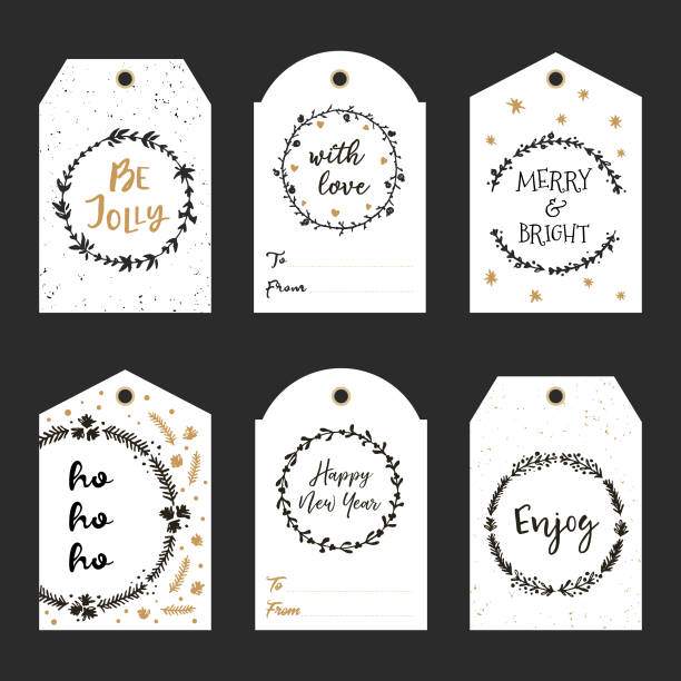 Christmas gift tags with hand drawn wreath and lettering. Decorative garlands with calligraphy Happy New Year, Be Jolly, Merry & Bright, With love, Enjoy, Ho ho ho. Vector printable tags. – artystyczna grafika wektorowa