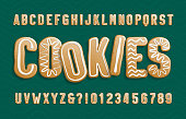 Christmas Gingerbread Cookies alphabet font. Cartoon letters and numbers with icing sugar covering.