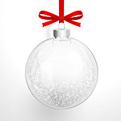Christmas glass ball closeup with a red bow and snow. Vector illustration EPS10, transparency