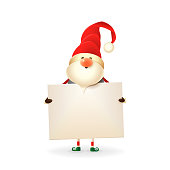 Christmas Gnome with red hat holds signboard