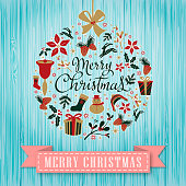 Christmas graphic elements form a Christmas ornament,  vintage blue color wooden background with paper scroll.
