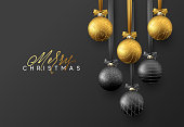 Christmas greeting card, design of xmas golden and black balls on dark background.