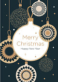 Christmas greeting card. Golden Christmas balls on a dark blue background