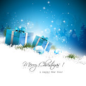 Christmas blue greeting card with gift boxes and branches in snow..