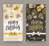 Christmas greeting card - Brush calligraphy greeting and ornate christmas baubles under snowfall.