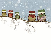 Christmas greeting card with family of owls and place for text
