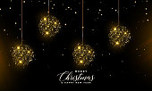 Christmas greeting card with golden balls on Black Background