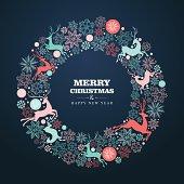 Christmas greeting card with reindeer wreath