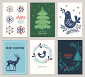 Vertical Merry Christmas and Happy Holidays cards with New Year tree, deer, decorative snowflakes, peace dove, bird and wreath on the texture backgrounds. Vector illustration.