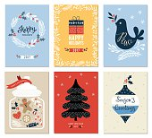 Merry Christmas and Happy Holidays cards set with New Year tree, gift box, dove, jar, ornaments andwreath. Vector illustration.