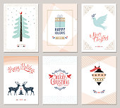 Merry Christmas and Happy Holidays cards set with New Year tree, reindeers, gift box, ornaments and typographic design.