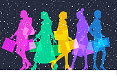 Colourful overlapping silhouettes of Christmas High Street shoppers