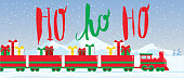 Vector illustration Christmas Holiday Train with gifts in a winter scene with mountains with hand lettered holiday greeting text. Easy to edit.