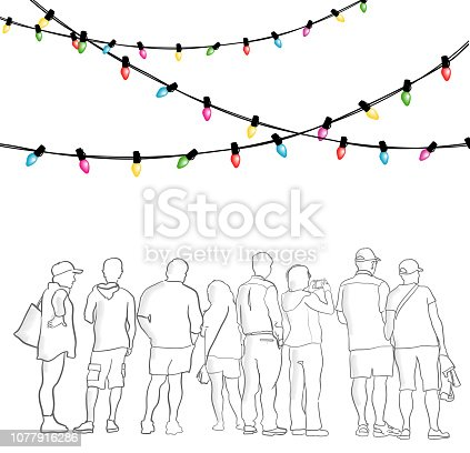 Large group of people under christmas lights