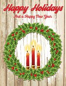 Christmas Holly Wreath With Candles On Old Wood