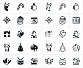 An icon set of both filled and outlined Christmas icons. The icons include santa claus, stocking, candycane, ornament, snowflake, calendar, gift, mittens, Christmas lights, reindeer, Christmas Tree, candle, holly, drum and snow globe to name a few.