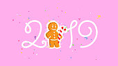 Christmas illustration. Vector. Gingerbread and inscription 2019. Cartoon Character with a caramel stick. Happy new year and christmas. Mascot. Illustration for the invitation and calendar.