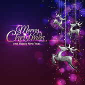 Reindeer ornatment in front of the christmas purple color background.