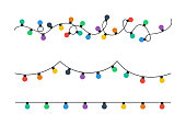 istock Christmas lights bulbs. Colorful christmas lights bulbs isolated on white background. Color garlands. Lights bulbs in simple trendy flat design. Christmas illustrtation. Vector illustrtation 1176513349