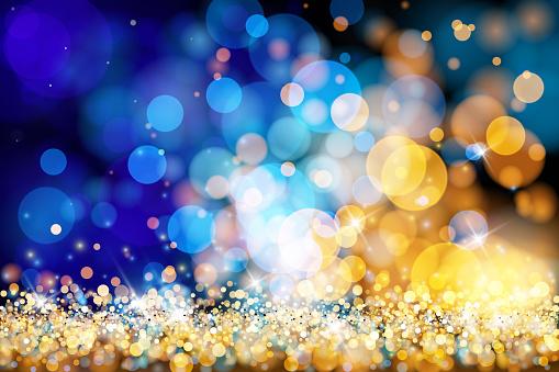 Christmas lights defocused background - Gold blue bokeh