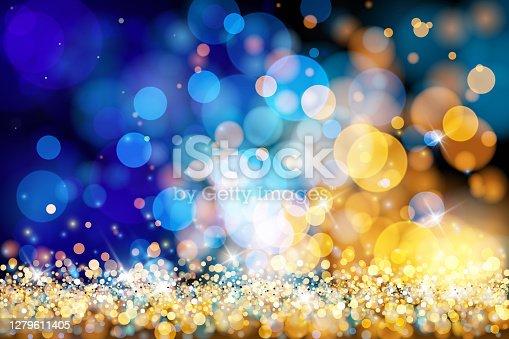 istock Christmas lights defocused background - Gold blue bokeh 1279611405