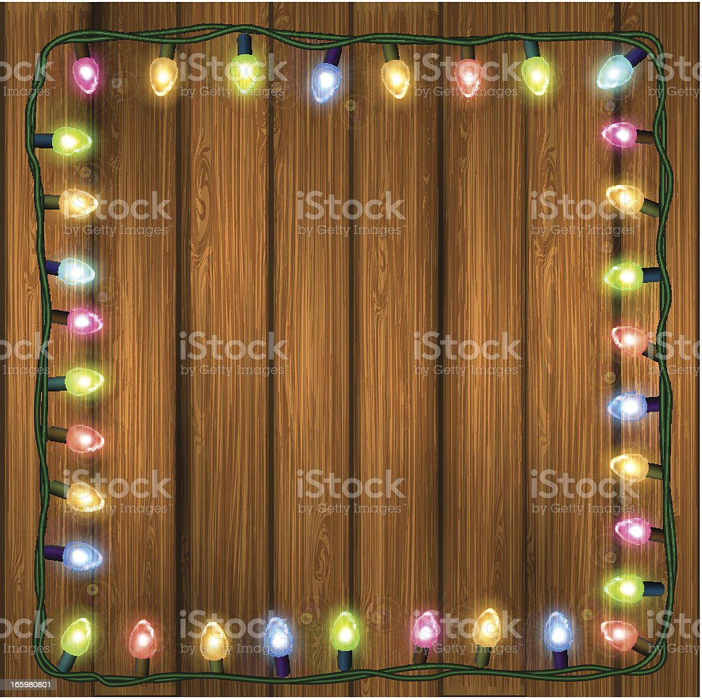 Christmas lights on a wooden background royalty-free stock vector art
