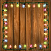 Vector background Christmas lights in wooden texture. EPS10. Contains transparency.