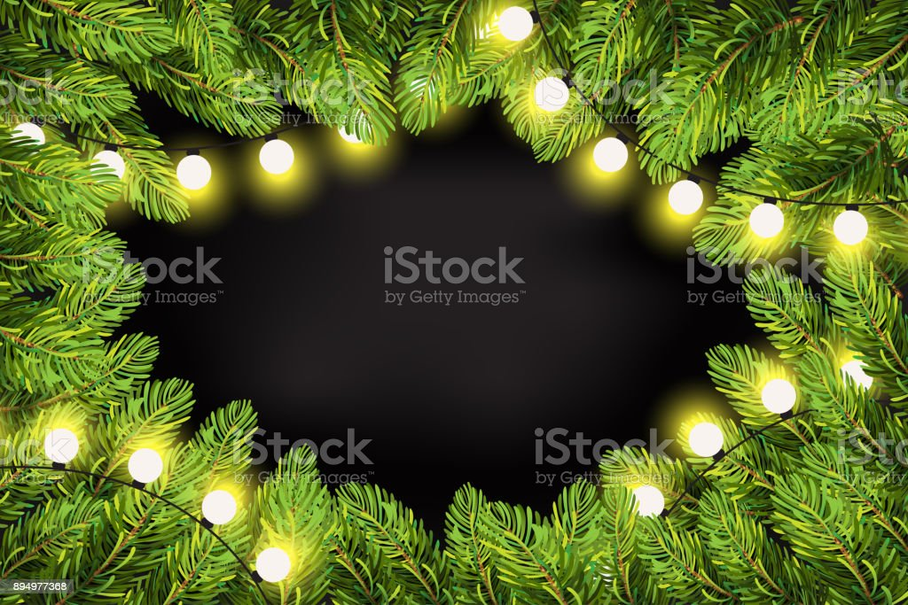 christmas lights on pine branches garland lights decorations and spruce fir tree winter holiday
