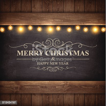 istock Christmas Lights on Wooden Boards and Chalkboard 515454161