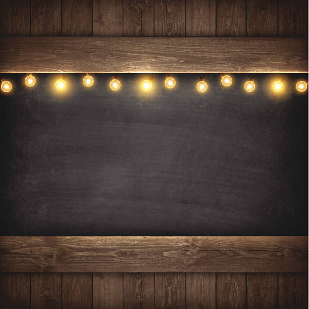 christmas lights on wooden boards and chalkboard - wood texture stock illustrations