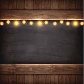 Christmas Lights on Wooden Boards and Chalkboard