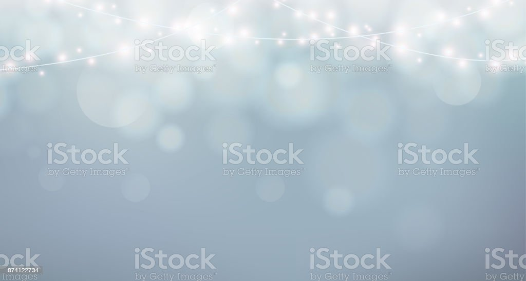 Christmas lights. Xmas garland decoration. Grey background with shine fog, bokeh