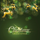Reindeer ornatment in front of the christmas green color background.