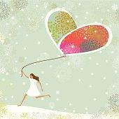 Little girl flying a heart-shaped balloon on christmas.