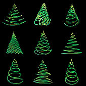 A set of simple abstract Christmas trees. Glowing lines and dots in the shape of a Christmas tree.