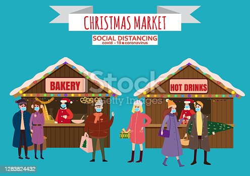 istock Christmas Market holiday fairs or festive on city square. In conditions of the COVID 2019 pandemic sellers in medical masks, Social distancing. People walk and buy between canopy, stalls bakery hot drinks . Background silhoutte old town, 1283824432