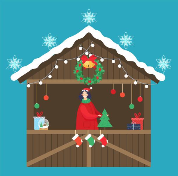 weihnachtsmarktverkäufer mit kiefer und geschenk - weihnachtsmarkt stock-grafiken, -clipart, -cartoons und -symbole