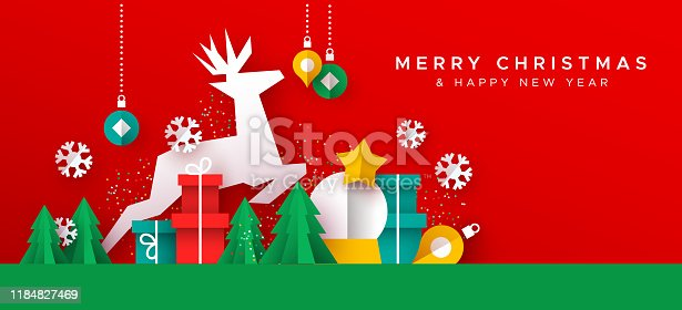 istock Christmas New Year card of paper cut toy landscape 1184827469