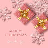 Christmas background with gift boxes and shiny snowflakes made of confetti. Design element for greeting card, party invitation or banner