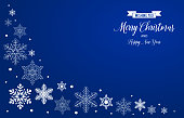 White snowflakes decoration on blue background, with greeting texts.