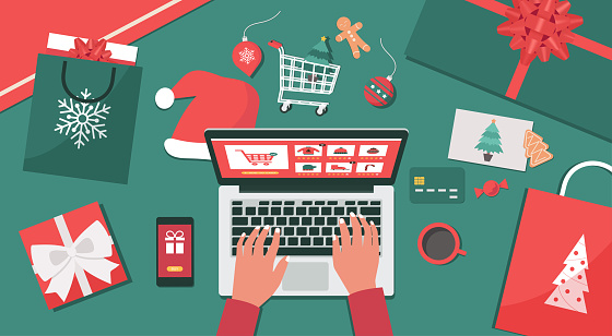Christmas online shopping top view, human hand makes order on laptop screen