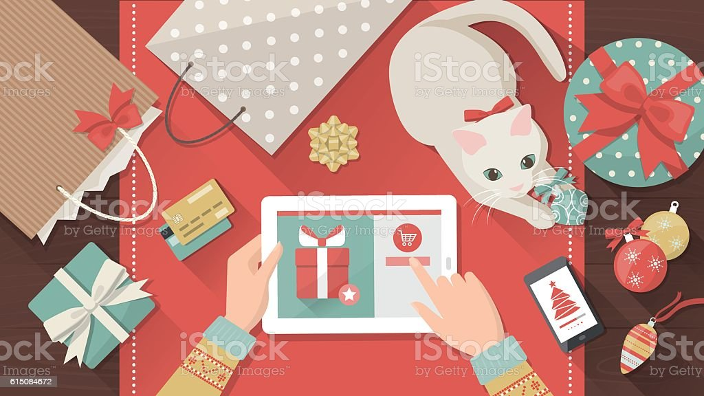 Christmas online shopping Woman purchasing Christmas gifts online using a tablet, her cat is playing with a bauble on the desk, holiday and celebrations banner Adult stock vector