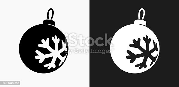 istock Christmas Ornament Icon on Black and White Vector Backgrounds 692905058