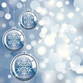 Transparent Christmas Ornaments on a Silver Glowing Lights Background. Room for your text.