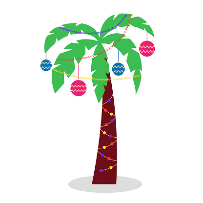 Christmas palm tree with garlands of tinsel and Christmas toys