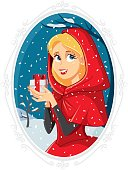 Vector illustration of a girl in read hood cape holding a present