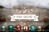 christmas reindeer  label on blurred  wooden background