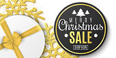 Christmas sale banner. Luxury greeting card. Gold glitter snowflakes, gift box. Xmas poster. Black round sticker. Merry Christmas and Happy New Year. Vector illustration