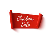 Christmas Sale banner. Red abstract ribbon isolated on white background. Vector illustration.