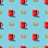 istock Christmas seamless pattern: red cups of tea (cocoa, chocolate) and sweet cookies, light blue background. 3d vector print, contrast, minimal concept. Winter holidays, new year, cozy breakfast. 1283847419